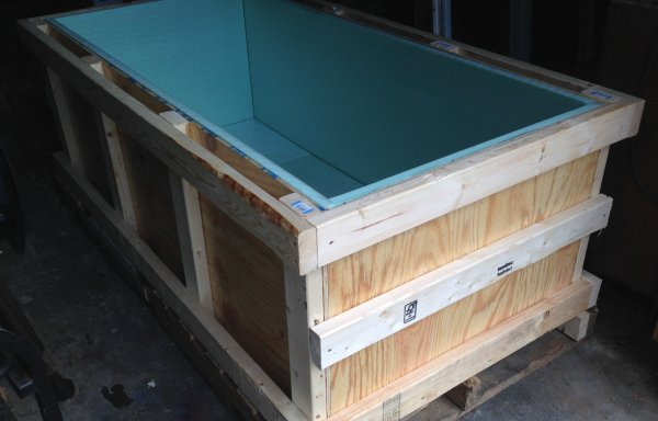 crate lined with plywood and rigid foam